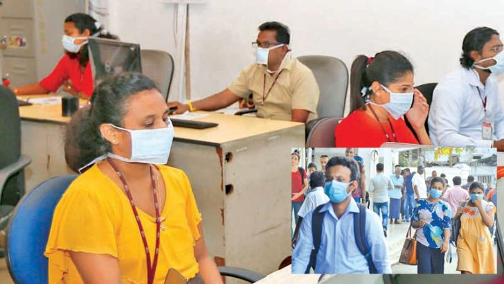 Heigthened AWARENESS: Sri Lankan employees attached to the public sector and the corporate sector began wearing face masks as a precautionary measure during work and while commuting to office using public transport with the authorities heightening awareness of deadly coronavirus after detection of a Chinese patient on Monday night. Pictures by Ranjith and Hirantha Gunathilake.