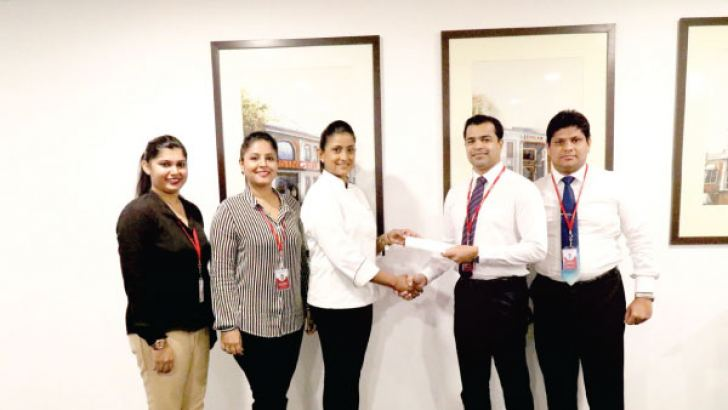 Singer Marketing team led by Shanil Perera, Marketing Director, Singer Sri Lanka (PLC) sharing the partnership agreement with Dushanthi Madanayake.