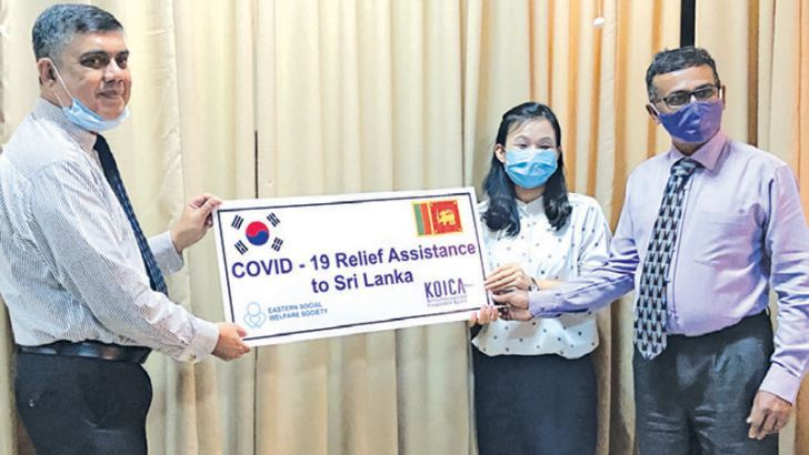 KOICA Country Director Kang Youn Hwa handing over the cheque to the Kandy District Secretary.