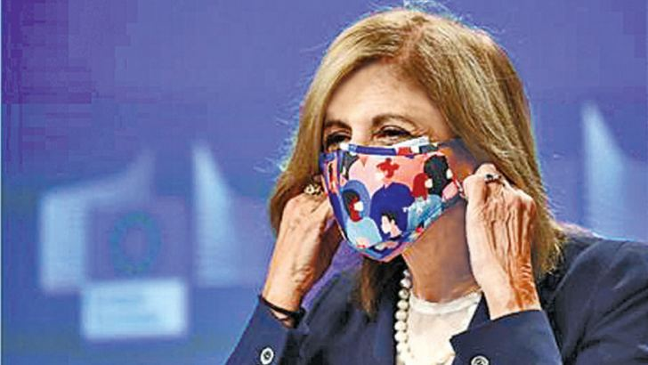 European Commissioner for Health Stella Kyriakides adjusts her face mask as she attends a news conference on the updated risk assessment for the novel coronavirus, COVID-19, in Brussels.- AFP