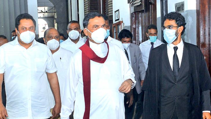 Former Minister and SLPP founder Basil Rajapaksa walking out of the Colombo High Court premises yesterday. Picture by Wasitha Patabendige.