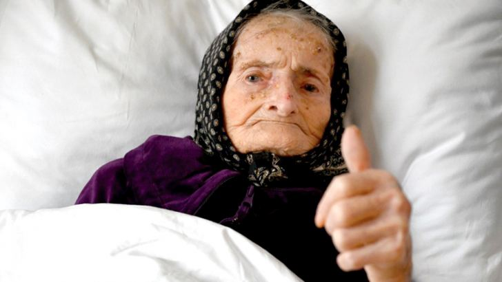 Croatian Margareta Kranjcec, 99, gives a thumbs up as she rests in her bed at an elderly people's home in Karlovac, Croatia on Thursday.- AFP