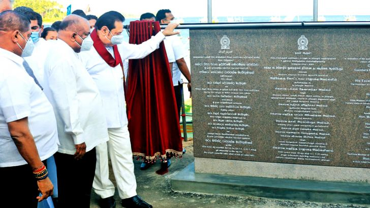 Prime Minister Mahinda Rajapaksa unveiling the plaque after initiating construction work of the Gandara Fisheries Harbour on Sunday. Speaker Mahinda Yapa Abeywardena was also present. Picture by Priyan De Silva
