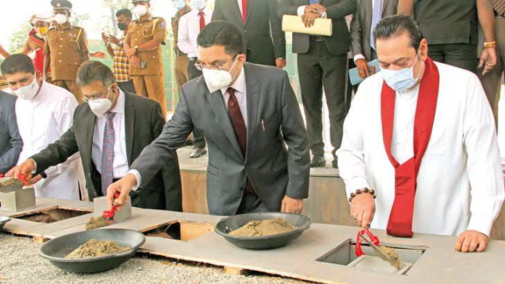 Prime Minister Mahinda Rajapaksa, Justice Minister Ali Sabry PC, Chief Justice Jayantha Jayasuriya and Prison Management State Minister Lohan Ratwatte laying the foundation stones for the Adhikarana Piyasa (House of Justice) at Hulftsdorp yesterday. Picture by Ruwan de Silva