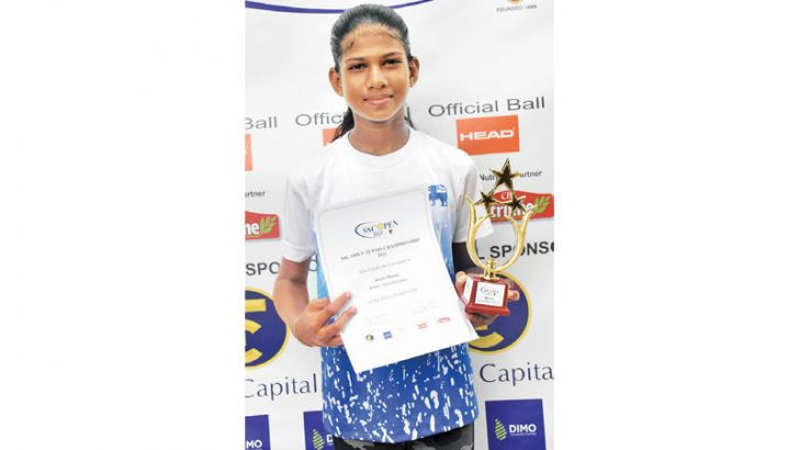 Arushi Thomas celebrates with the trophy
