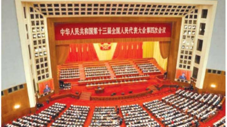 Chinese Prime Minister Li Keqiang delivers a speech during the opening session of China's National People's Congress (NPC) at the Great Hall of the People in Beijing yesterday.