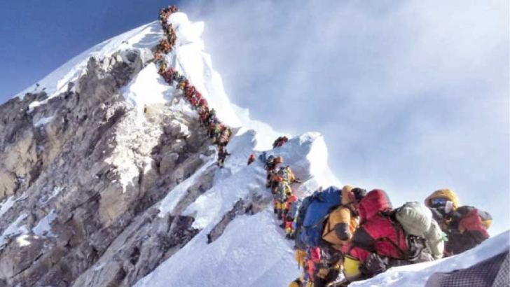 A long queue of mountain climbers line a path on Mount Everest during the 2019 climbing season.