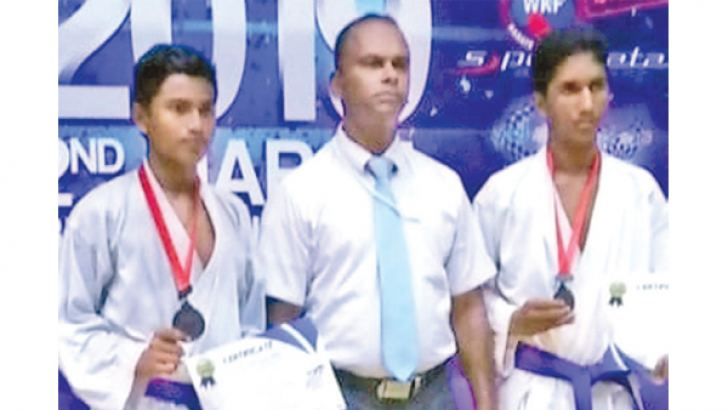 Kavinda Kaushan on extreme right in the picture with his coach after receiving his Black Belt (Picture by – Dilwin Mendis Moratuwa Sports Special Correspondent)