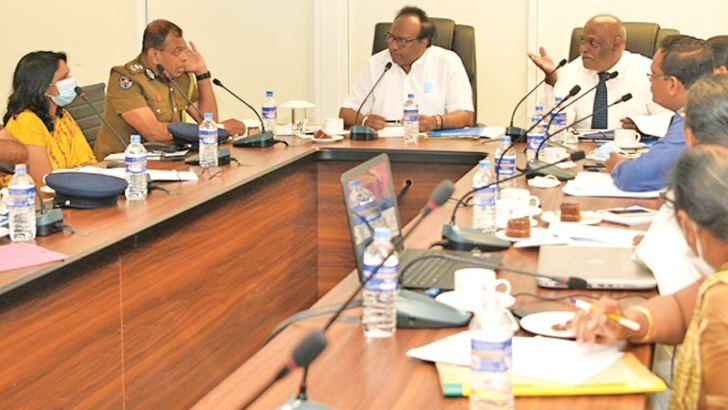 Public Security Minister Rear Admiral Dr. Sarath Weerasekera discussing the issue with officials.