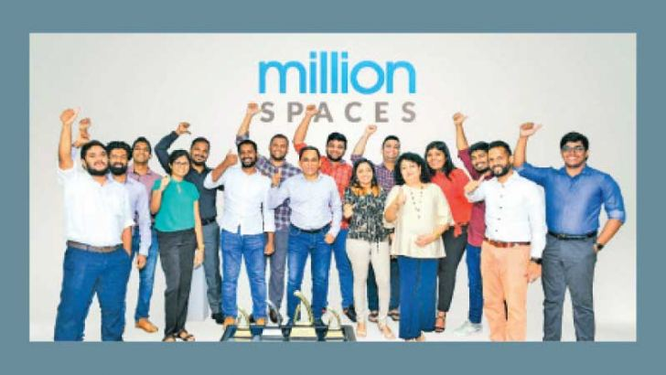 The team at Million Spaces with their awards