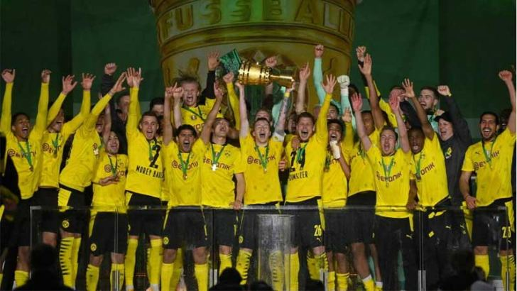 Members of Borussia Dortmund celebrate with the trophy