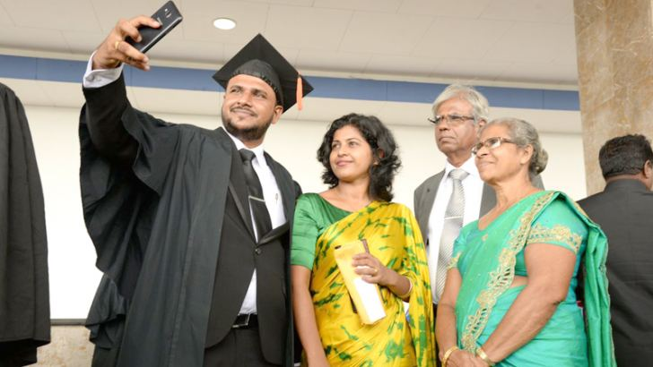 An OUSL graduate with his family