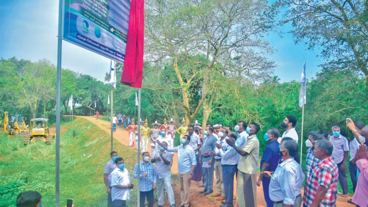 A construction work on a water project being inaugurated.