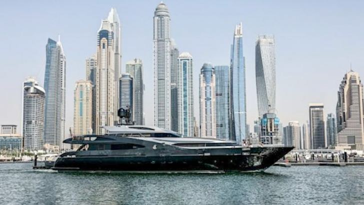 A luxury yacht is pictured off the Dubai Marina Beach.