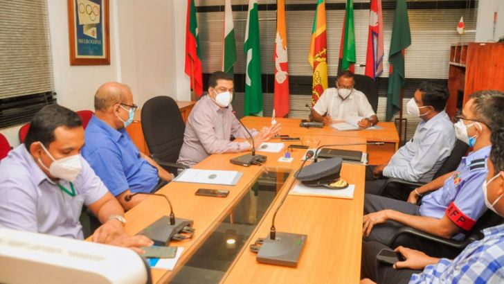 President, NOCSL Suresh Subramaniam (centre) outlining his plans for the promotion of beach volleyball in Sri Lanka flanked by President, SLVF Kanchana Jayaratne (left) and Secretary, SLVF A. S. Nalaka (right)