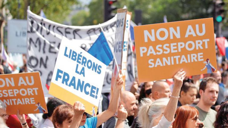 """A protester holds a placard that reads """"No to the health passport"""" during a demonstration in the French capital Paris on Saturday."""