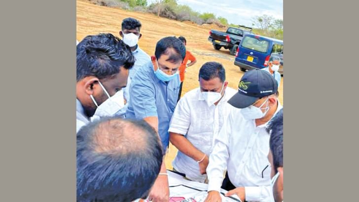 CDA Chairman Keerthi Sri Weerasinghe and BoI officials inspecting the plan of the land allocated for the project at the proposed site.