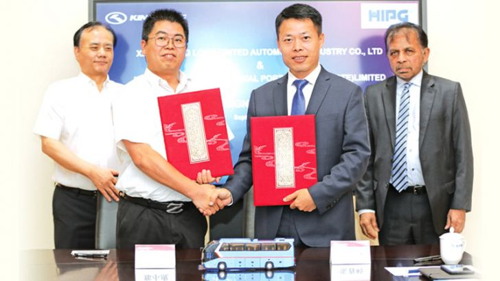 Zhang Bin, Vice President of King Long Motor Group, Zheng Xiaohu, Special Assistant to the President Xiamen King Long, Justin Zhan- General Manager Port Investment Services HIPG and Dr. Palitha Kohona Sri Lanka's Ambassador to China in Beijing after signing of the MOU