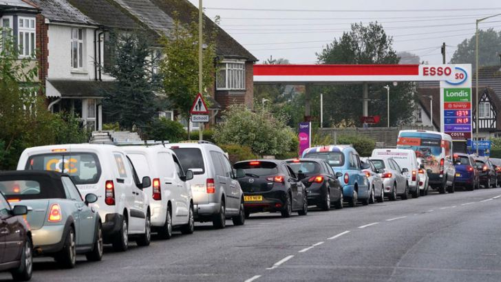 A long line of cars waiting for fuel in the UK