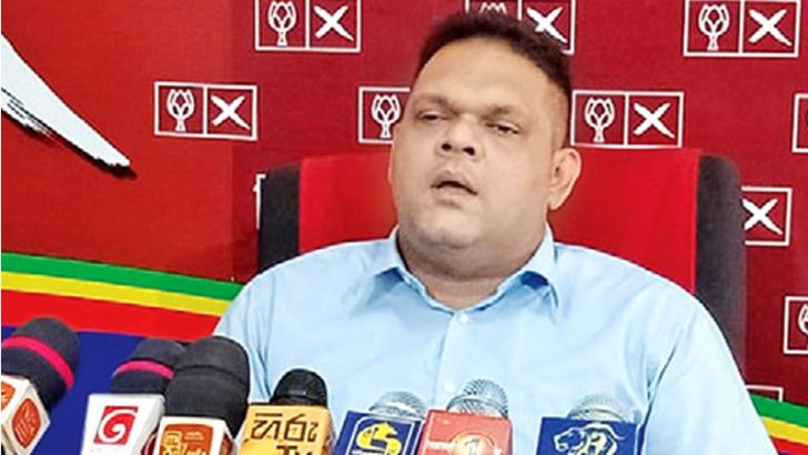 State Minister Shehan Semasinghe addressing  the press briefing.