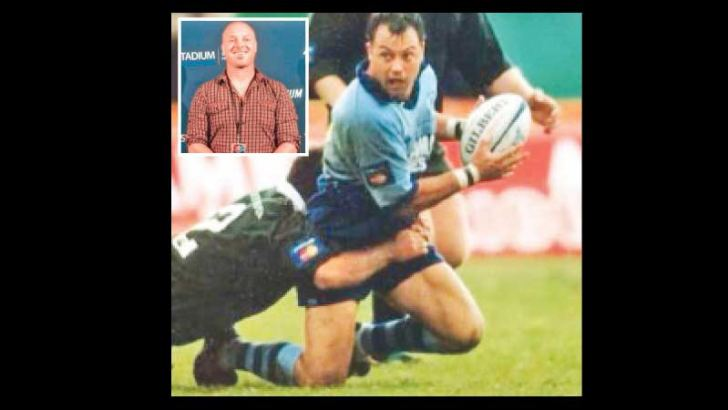 Former CR and FC ruggerite Australian Paul Bennett is being held by an opponent while playing for Parramatta in the Australian Rugby League