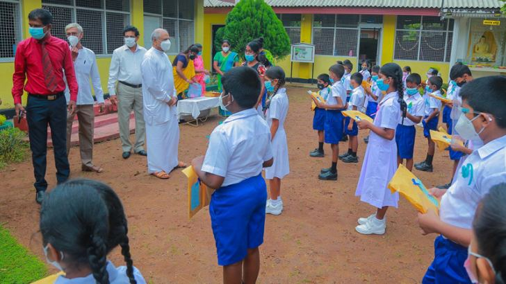 Education Minister Dinesh Gunawardena welcomed students at the Maharagama Buddhist College after an inspection visit he made to several schools yesterday.