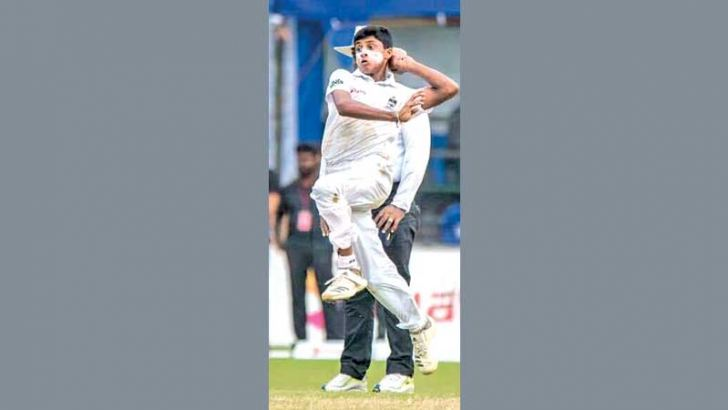 St.Peters and Sri Lanka national under 19 left arm fast bowler Danal Hemananda in action.