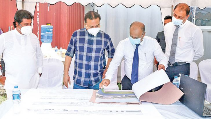 CEO Abans Electricals Jagath Jayasundara displaying the structure of the proposed AC and Refrigerator manufacturing facility to Minister Wimal Weerawansa at Millenia.