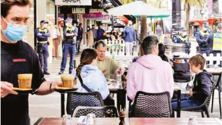Diners eat outside a cafe in St Kilda following the ending of the COVID-19 lockdown in Melbourne, Australia on Sunday.